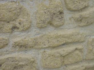 Détail pierre sculptée et patinée