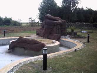 bassins, imitation bois, imitation pierre, bassin recouvert de faux rochers